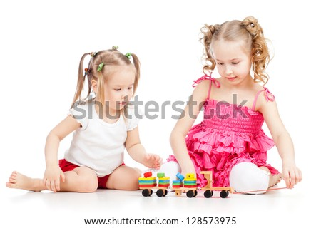 two kids sisters play together, isolated on white background - stock photo