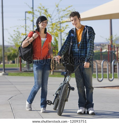 Two kids walk home - stock photo
