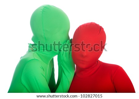 Two kids wearing bright, colorful spandex body suits.  One is red, the other is green.