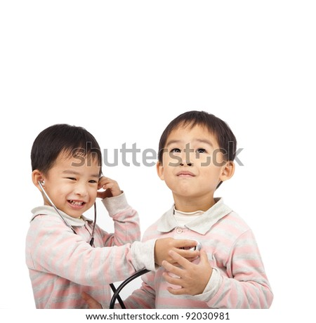 two kids with health examination by stethoscope - stock photo