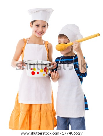 Two kids with pan and big ladle tasting the soup, isolated on white - stock photo