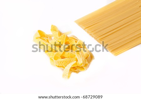 Two kinds of a spaghetti on a white background - stock photo