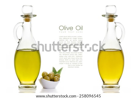 Two kinds of Olive Oil on Two Glass Bottles with Olive Seeds on White Bowl at the Left Side. Isolated on White Background. Design Template with Sample Text at the Center - stock photo