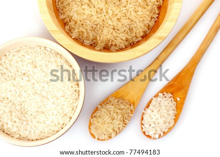 Two kinds of rice in spoons - stock photo