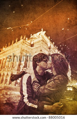 Two kissing in Praha, Czech Republic at night. Photo in multicolor style.