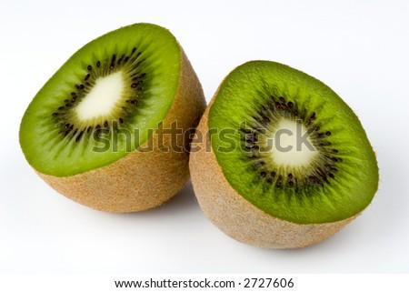 Two kiwifruit halves, isolated on white - stock photo