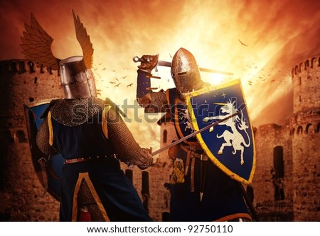 Two knights fighting against medieval castle. - stock photo