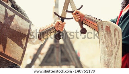 Two knights with swords and shileds - stock photo
