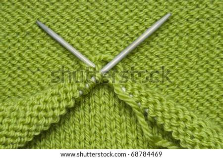 Two Knitting spokes, Wool yarn And Knitting - stock photo