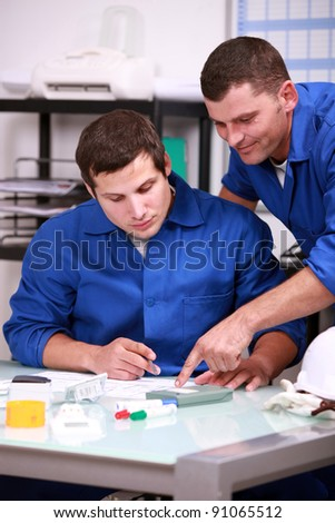 Two laborers in office - stock photo