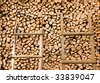 Two ladders on a background of firewood - stock photo