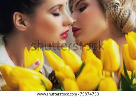 Two ladies kissing - stock photo