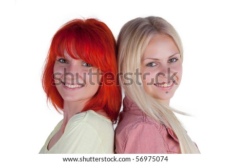Two ladies posing on a white background - stock photo