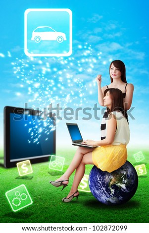 Two lady look at the Car icon from tablet computer : Elements of this image furnished by NASA - stock photo