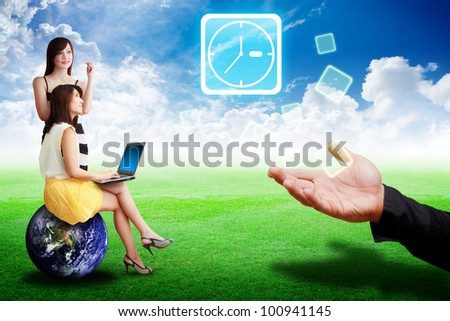 Two lady look at the Clock icon from business man on grass field : Elements of this image furnished by NASA - stock photo