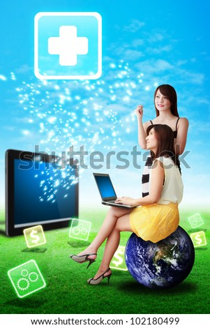 Two lady look at the First Aid icon from tablet computer : Elements of this image furnished by NASA - stock photo