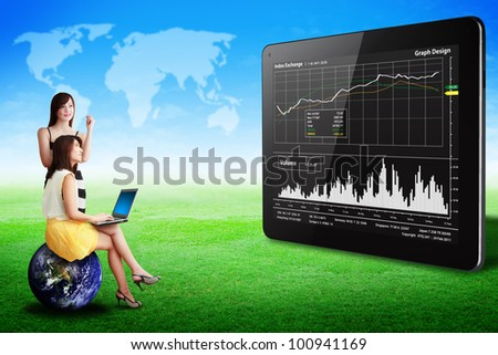 Two lady look at the Graph report on tablet computer on grass field : Elements of this image furnished by NASA - stock photo