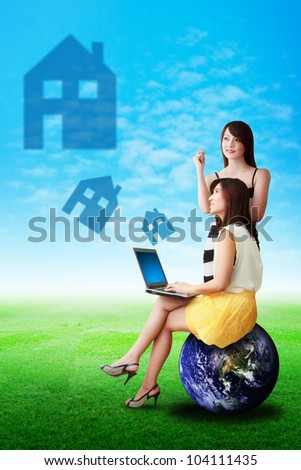 Two lady look at the house icon on the sky : Elements of this image furnished by NASA - stock photo