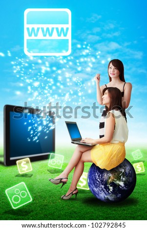 Two lady look at the WWW icon from tablet pc : Elements of this image furnished by NASA - stock photo