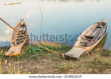 Two laid up wooden boats   - stock photo