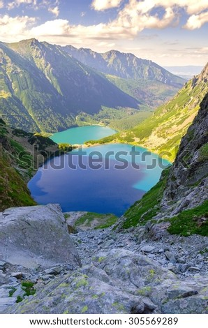 Two lakes in mountains. Two blue mountain lakes surrounded by high summits. Morskie Oko (Eye of the Sea) and Czarny Staw (Black Pond) are the most popular place in High Tatra Mountains, Poland.