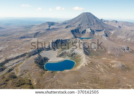 Two lakes in the Tongariro national park in front of mount Ngauruhoe - stock photo