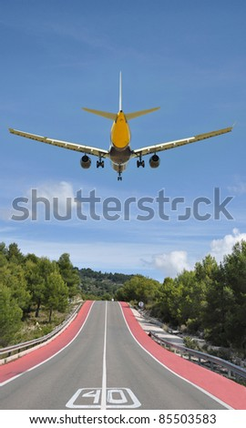 Two Lane Highway Speed Limit Forty Airplane Flying Above - stock photo