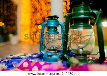 Two lanterns on beautiful golden  bokeh background  - stock photo