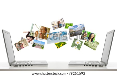 two laptops are sharing photos by air. All flying photos you can find at my portfolio. - stock photo