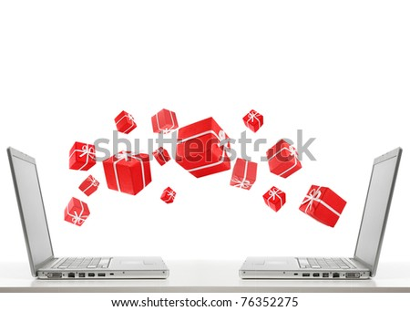 two laptops are sharing red gift boxes by air - stock photo