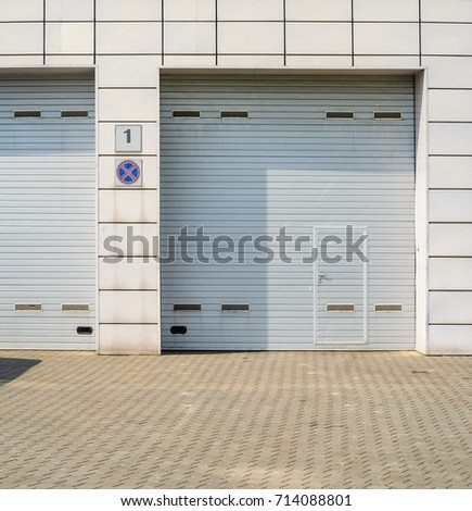 Two Large Automatic Over Garage Door Stock Photo 714088801