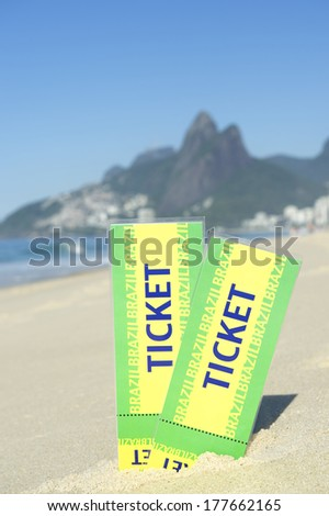 Two large Brazil tickets in the sand on the Ipanema Beach in Rio de Janeiro with Dois Irmaos Mountain in the background