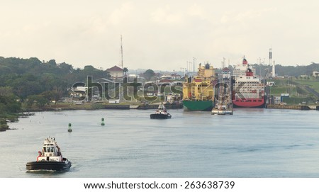 Two large ships wait to transit the Miraflores locks in the Panama Canal, just outside Panama City. - stock photo