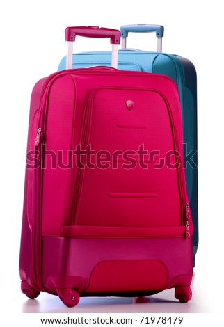 Two large suitcases isolated on white. Travel luggage