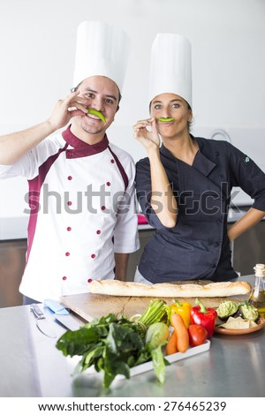 Two latin chefs posing in a cooking school - stock photo