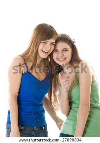 Two laugh teenage girls. Isolated on white background - stock photo