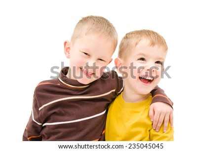 Two laughing boy embracing isolated on white background - stock photo