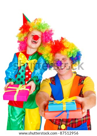 Two laughing clowns with birthday presents, isolated - stock photo