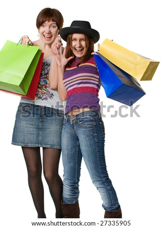 Two laughing girls with the coloured packages, isolated on white