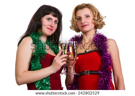 Two laughing women at party celebrating with champagne - stock photo
