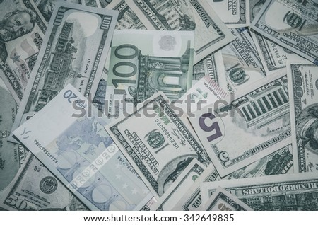 Two leading currency - US Dollar vs Euro. tinted photo - stock photo