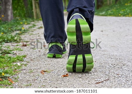 Two legs walking in spring park - stock photo