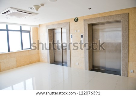 Two lifts in a hotel hall - stock photo