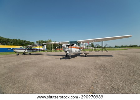 Two light planes parked on the private airfield in summer - stock photo