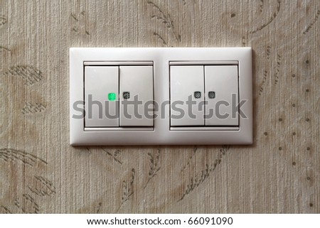 Two light switches on  wall - stock photo