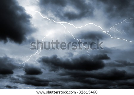 Two lightening bolts flash through a dark dramatic sky - stock photo