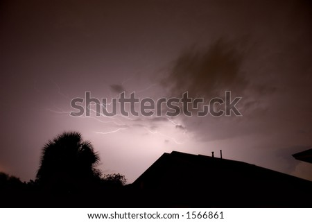 Two lightning strikes loop back into each other - stock photo
