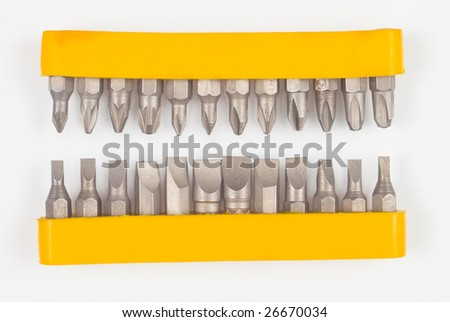 two lines of screw driver bits - stock photo
