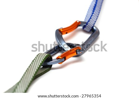 two linked carabiners - stock photo