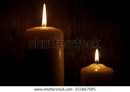 Two lit candles in the dark - stock photo